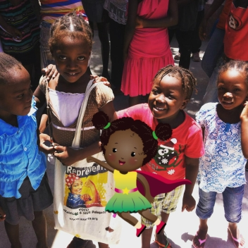 TravelmakingKai with children in Haiti